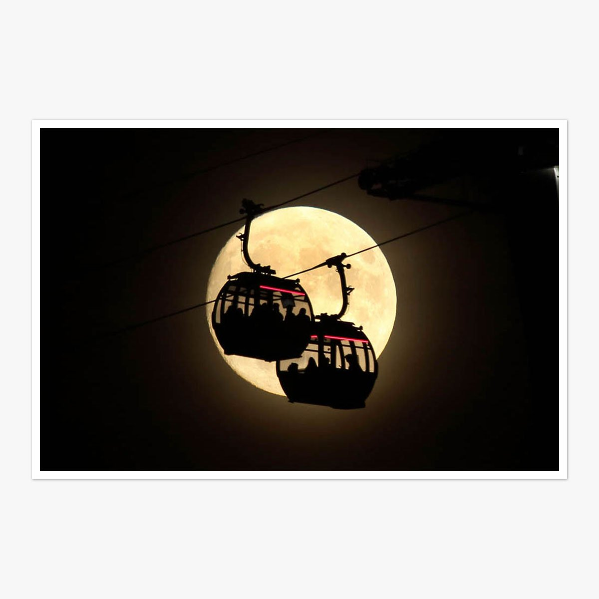 Cable Cars Pass Super Moon by Roger Jackson